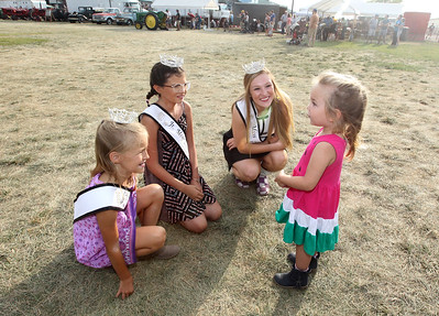 Candace H. Johnson-For Shaw Media Newly crowned Lake County Fair Queens Jenna Marasco, 8, Lily Troyan, 13, and Teaghan Callaway, 19, all of Lake Villa, talk with Evelyn Jean Smolucha, 3, of Lincolnshire during the Lake County Fair at the Lake County Fairgrounds in Grayslake. (7/28/18)