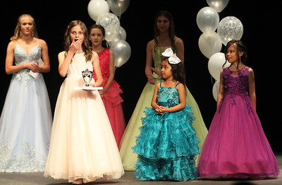 Candace H. Johnson-For Shaw Media Kailee Albeck, 8, of Round Lake (second from left) reacts to winning the title of Little Miss Round Lake Area 2019 during the Round Lake Area Pageant at the Round Lake Beach Cultural & Civic Center. (6/27/19)