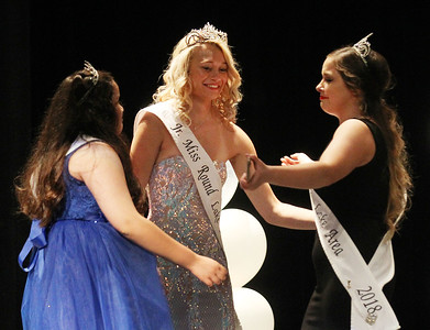Candace H. Johnson-For Shaw Media Little Miss Jaelyne Ochoa, 10, Junior Miss Emilia Judin, 15, and Miss Christina Larson, 20, 2018 queens embrace before the crowning of the new 2019 Round Lake Area queens during the Round Lake Area Pageant at the Round Lake Beach Cultural & Civic Center. (6/27/19)