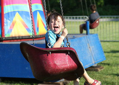 Candace H. Johnson-For Shaw Media Riley Hahn, 5, of Grayslake rides the swings during the Taste of Grayslake Family Picnic & Fireworks in Central Park in Grayslake. (6/29/19)