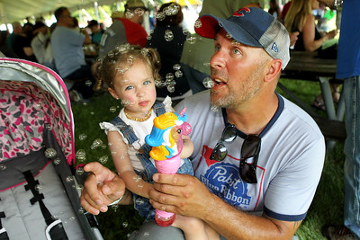 Candace H. Johnson-For Shaw Media Brynlee Dillow, twenty-months-old, of Beach Park and her father, Ryan, play with her new bubble wand during the Taste of Grayslake Family Picnic & Fireworks in Central Park in Grayslake. (6/29/19)