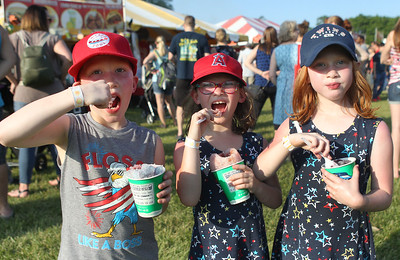 Candace H. Johnson-For Shaw Media Ryan, Emily and Nora Flores, all 7, triplets from Grayslake enjoy some shaved ice to stay cool during the Taste of Grayslake Family Picnic & Fireworks in Central Park in Grayslake. (6/29/19)