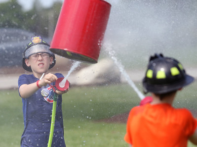 Candace H. Johnson-For Shaw Media Dylan Johnson, 11, of Wauconda and Nathen Masterson, 10, of Bristol, Wis., push the barrel with a hose as they compete in the Wauconda Fire Department's Kids Water Fights during Wauconda Fest at Cook Park. (6/29/19)