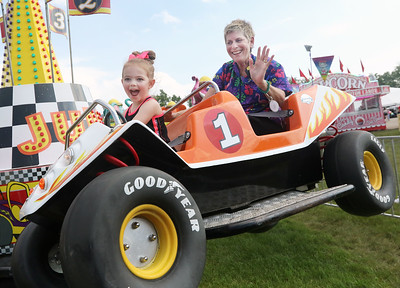 Candace H. Johnson-For Shaw Media Kendall Quick, 3, of Island Lake and her grandmother, Lisa Quick, of Wauconda enjoy the Baja Buggy ride during Wauconda Fest at Cook Park in Wauconda. (6/29/19)