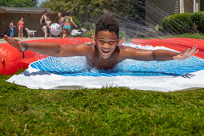 Elijah Morgan (age 11) from Gilberts cools off before the start of the Crystal Lake Independence Day parade Sunday, July 7, 2019 on Dole Avenue in Crystal Lake.  KKoontz - For Shaw Media