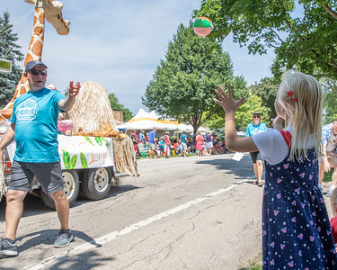 Willow Christiansen (age 7) catches a ball thrown her way during the Crystal Lake Independence Day parade Sunday, July 7, 2019 on Dole Avenue in Crystal Lake.  KKoontz - For Shaw Media