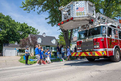 "During the Crystal Lake Independence Day parade along Dole Avenue, some county residents showed their support by wearing blue for Andrew ""A.J."" Freund in front of the home where he was allegedly killed by his parents. The annual parade was held Sunday, July 7, 2019 in Crystal Lake.  KKoontz - For Shaw Media"