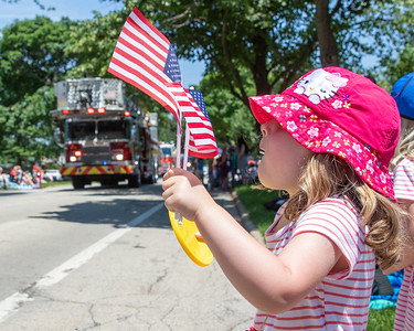 Rory Coltman (3 yrs) from Woodstock waves her flags during the Crystal Lake Independence Day parade Sunday, July 7, 2019 on Dole Avenue in Crystal Lake.  KKoontz - For Shaw Media