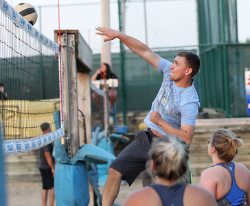"Candace H. Johnson-For Shaw Media Andy Lemke, of McHenry with the team called, ""I'd Hit That,"" makes an attack against ""Calm Your Tips,"" during a Sideouts Beach Volleyball League Tuesday night Intermediate 6's game in Island Lake. (7/9/19)"