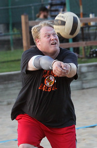 "Candace H. Johnson-For Shaw Media Greg Carlson, of McHenry with the ""Calm Your Tips,"" team passes the ball against the ""I'd Hit That,"" team during a Sideouts Beach Volleyball League Tuesday night game in Island Lake. (7/9/19)"