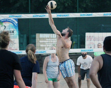 "Candace H. Johnson-For Shaw Media Bryan Wiener, of Round Lake with the ""We Showed Up"" team gets the ball over the net against ""Gratuitous Sets & Violence"" during a Sideouts Beach Volleyball League Tuesday night game in Island Lake. The ""We Showed Up"" team won.(7/9/19)"