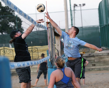 "Candace H. Johnson-For Shaw Media Kevin Bohman, of Lake in the Hills, with the team called, ""Calm Your Tips,"" tries to block an attack by Andy Lemke, of McHenry with ""I'd Hit That"" during a Sideouts Beach Volleyball League Tuesday night game in Island Lake. (7/9/19)"