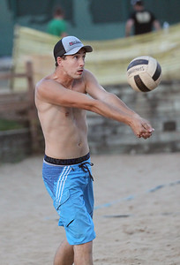 "Candace H. Johnson-For Shaw Media Brad DeRaedt, of Lake in the Hills, with the ""Gratuitous Sets & Violence,"" team passes the ball against ""We Showed Up"" during a Sideouts Beach Volleyball League Tuesday night Intermediate 6's game in Island Lake. (7/9/19)"