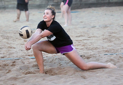 "Candace H. Johnson-For Shaw Media Taylor Drake, of Lake Villa with the ""We Showed Up,"" team gets down low to pass the ball against ""Gratuitous Sets & Violence"" during a Sideouts Beach Volleyball League Tuesday night Intermediate 6's game in Island Lake. (7/9/19)"