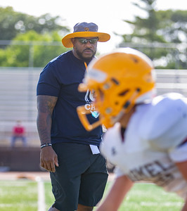 Carmel Catholic High School assistant football coach and former Chicago Bear Jason McKie runs practice drills Monday, July 15, 2019  in Mundelein  KKoontz – For Shaw Media