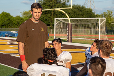 Carmel Catholic High School head football coach and former Chicago Bear Blake Annen talks with his team after practice Monday, July 15, 2019 in Mundelein  KKoontz – For Shaw Media