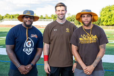Carmel Catholic High School head football coach Blake Annen (center) along with assistant coaches Jason McKie (left) and Johnny Knox (right) pose for a photo following practice Monday, July 15, 2019 in Mundelein. All are former Chicago Bear football players.  KKoontz – For Shaw Media