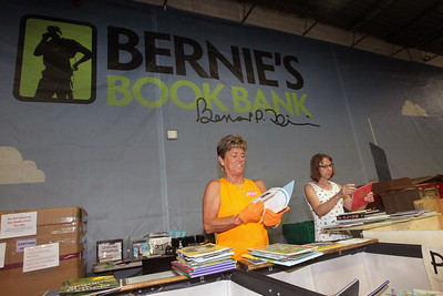 Candace H. Johnson-For Shaw Media Volunteers Rita Gertie, of Chicago and Carol Schacherer, of Deerfield check over books as they separate them into grade levels during the 10th Anniversary Celebration & Volunteer-A-Thon at Bernie's Book Bank in Lake Bluff. Both volunteers are regulars at the book bank. Gertie has volunteered over 600 hours.(7/13/19)