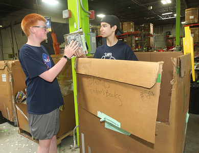 Candace H. Johnson-For Shaw Media Tommy Diesen, of Vernon Hills and Anthony Villanueva, of Grayslake, both 15, sort books to be put into large boxes during the 10th Anniversary Celebration & Volunteer-A-Thon at Bernie's Book Bank in Lake Bluff. (7/13/19)