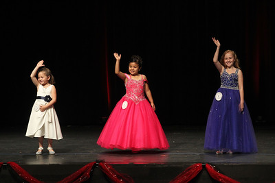 Candace H. Johnson-For Shaw Media Little Miss Gurnee 2019 contestants Ana Schuessler, Melanie Mateos and Ivy Lindstrom wave to their friends and family dressed in formal wear during the Gurnee Community Pageant at Warren Township High School. (7/13/19)