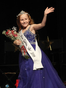 Candace H. Johnson-For Shaw Media Ivy Lindstrom, 9, waves to the crowd as she takes her first walk on stage crowned Little Miss Gurnee 2019 during the Gurnee Community Pageant at Warren Township High School. (7/13/19)