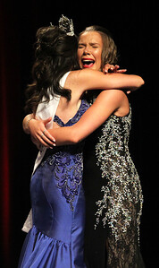 Candace H. Johnson-For Shaw Media Outgoing 2018 Miss Gurnee Emily Kellogg hugs Lauren Allen, both 19, after she just found out she won the title of 2019 Miss Gurnee during the Gurnee Community Pageant at Warren Township High School. (7/13/19)