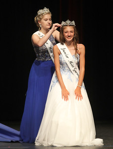 Candace H. Johnson-For Shaw Media Kirsten Sheppard, 16, Junior Miss Gurnee 2018 puts a crown on Audrey Hetman, 13, after she won the title, Junior Miss Gurnee 2019, during the 2019 Gurnee Community Pageant at Warren Township High School. (7/13/19)