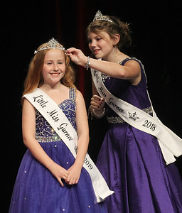 Candace H. Johnson-For Shaw Media Ivy Lindstrom, 9, is all smiles as she gets her crown put on and adjusted by 2018 Little Miss Gurnee Emma Casey, 11, after winning the title, Little Miss Gurnee 2019, during the Gurnee Community Pageant at Warren Township High School. (7/13/19)
