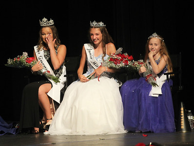 Candace H. Johnson-For Shaw Media Lauren Allen, 19, wipes away tears as she sits next to Audrey Hetman, 13, and Ivy Lindstrom, 9, for the first time after they were just crowned the new 2019 Gurnee queens during the 2019 Gurnee Community Pageant at Warren Township High School. (7/13/19)