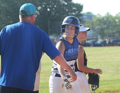 Candace H. Johnson-For Shaw Media Warren Wave 16U Blue's Chuck Willis, of Gages Lake, head coach, high-fives Bria Verber, 15, of Lake Villa on third for her triple against Kenosha Sting during the 15th Annual Warren Wave Wipeout Fastpitch Tournament at the Warren Township Center in Gurnee. (7/13/19)