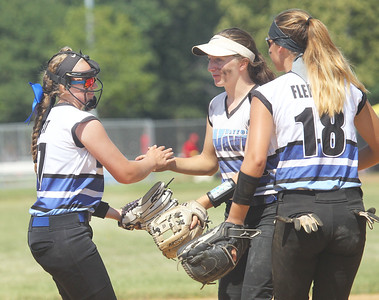 Candace H. Johnson-For Shaw Media Warren Wave 16U Silver's Rachel Peat is congratulated by Brooke Mangler and CC Fleming for striking a Lake in the Hills Hurricanes batter out in their game during the 15th Annual Warren Wave Wipeout Fastpitch Tournament at the Warren Township Center in Gurnee.The Warren Wave 16U Silver team won 3-0.  (7/14/19)