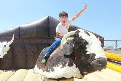 Candace H. Johnson-For Shaw Media Anthony Kiriychuk, 8, of Barrington rides a mechanical bull during the 56th Annual IPRA Championship Wauconda Rodeo at the Golden Oaks Equestrian Center in Wauconda. (7/14/19)