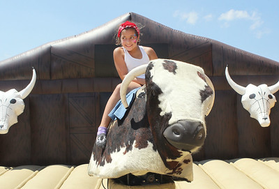 Candace H. Johnson-For Shaw Media Zoey Muir, 8, of Fox Lake rides a mechanical bull during the 56th Annual IPRA Championship Wauconda Rodeo at the Golden Oaks Equestrian Center in Wauconda. (7/14/19)
