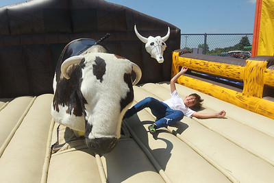 Candace H. Johnson-For Shaw Media Anthony Kiriychuk, 8, of Barrington falls off a mechanical bull during the 56th Annual IPRA Championship Wauconda Rodeo at the Golden Oaks Equestrian Center in Wauconda. (7/14/19)