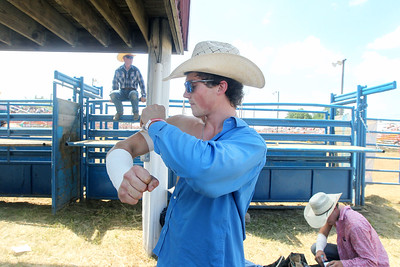 Candace H. Johnson-For Shaw Media Jessie Troyer, 21, of Columbia, Ky. wraps his arm with tape before competing in the Bareback Bronc Riding competition during the 56th Annual IPRA Championship Wauconda Rodeo at the Golden Oaks Equestrian Center in Wauconda. (7/14/19)