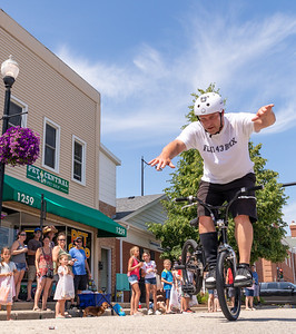 A BMX rider puts on a show during the 2019 Fiesta Days Parade Sunday, July 21, 2019 in McHenry. KKoontz – For Shaw Media