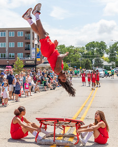 The Jessie White Tumblers perform on Green Street during the 2019 Fiesta Days Parade Sunday, July 21, 2019 in McHenry. KKoontz – For Shaw Media