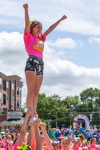 The McHenry Jr. Warrior Cheer and Dance team perform on Green Street during the 2019 Fiesta Days Parade Sunday, July 21, 2019 in McHenry. KKoontz – For Shaw Media