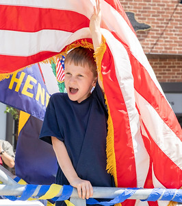 Truman Lester (age 7) from McHenry waves to the crowd from the Cub Scout Den 311 float during the 2019 Fiesta Days Parade Sunday, July 21, 2019 in McHenry. KKoontz – For Shaw Media