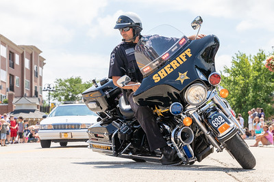 The McHenry County Sherriff's do some tight maneuvers on Green Street during the 2019 Fiesta Days Parade Sunday, July 21, 2019 in McHenry. KKoontz – For Shaw Media