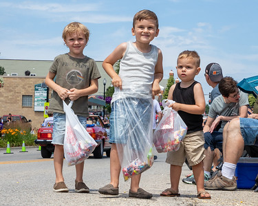Parker Bates (age 5) (Left to Right), Payton Carstens (age 5), and Wyatt Carstens (age 2) fill their bags with candy during on Green Street during the 2019 Fiesta Days Parade Sunday, July 21, 2019 in McHenry. KKoontz – For Shaw Media