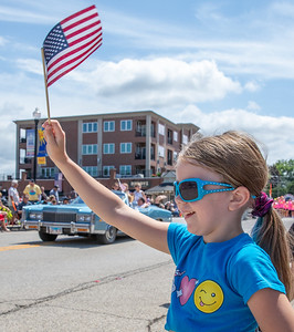 Brooklyn Larson (age 6) from Wonder Lake waves to the floats passing by during the 2019 Fiesta Days Parade Sunday, July 21, 2019 in McHenry. KKoontz – For Shaw Media