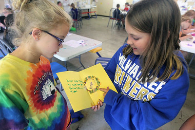Candace H. Johnson-For Shaw Media Alli Kavich, of Antioch listens to Brooklyn Maxson,of Lake Villa, both 9, talk about the inspirational card she wrote to a child at St. Jude Children's Research Hospital during Camp Kindness Week at Lake Villa Township's Peacock Camp in Lake Villa. (7/23/19)