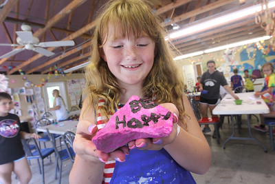 "Candace H. Johnson-For Shaw Media Annika Oksanen, 10, of Antioch shows the rock she painted with a message of kindness titled, ""Be Happy,"" during Camp Kindness Week at Lake Villa Township's Peacock Camp in Lake Villa. (7/23/19)"