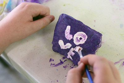 Candace H. Johnson-For Shaw Media Raelin Bechelli, 10, of Lake Villa paints the word, Love, on a rock as her word of kindness during Camp Kindness Week at Lake Villa Township's Peacock Camp in Lake Villa. (7/23/19)