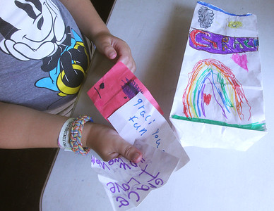 Candace H. Johnson-For Shaw Media Grace Salgado, 5, of Antioch shows off notes of kindness other campers gave to her during Camp Kindness Week at Lake Villa Township's Peacock Camp in Lake Villa. (7/23/19)
