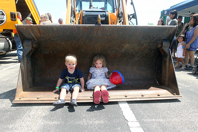 Candace H. Johnson-For Shaw Media Aleksander Rogowski, 2, of Round Lake Beach and his sister, Raelynn, 5, take a seat in a Lake Villa Township Highway Dept. Case 580 Super N Loader backhoe during Touch-a-Truck at the Metra parking lot next to the Round Lake Beach Cultural & Civic Center. (7/20/19)