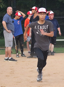 Candace H. Johnson-For Shaw Media David Ha, 19, of Buffalo Grove with the Crusaders Silver team takes off running as he rounds the bases at the end of practice for conditioning during the Special Recreation Association of Central Lake County (SRACLC) softball practice at Deerpath Park in Vernon Hills. The Crusaders Silver team was practicing for their district tournament in Elgin on August 3rd. (7/23/19)