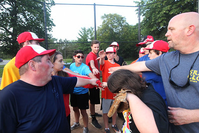 Candace H. Johnson-For Shaw Media The Crusaders Silver softball team huddle together at the end of practice during the Special Recreation Association of Central Lake County (SRACLC) softball practice at Deerpath Park in Vernon Hills. The Crusaders Silver team was practicing for their district tournament in Elgin on August 3rd. (7/23/19)