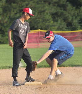 Candace H. Johnson-For Shaw Media David Ha, 19, of Buffalo Grove is safe on first under the tag by Mark Brady, 18, of Vernon Hills, during  Special Recreation Association of Central Lake County (SRACLC) softball practice for the Crusaders Silver team at Deerpath Park in Vernon Hills. The Crusaders Silver team was practicing for their district tournament in Elgin on August 3rd. (7/23/19)